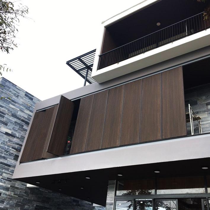 Hệ cửa lam elip xoay tự động Ecowood